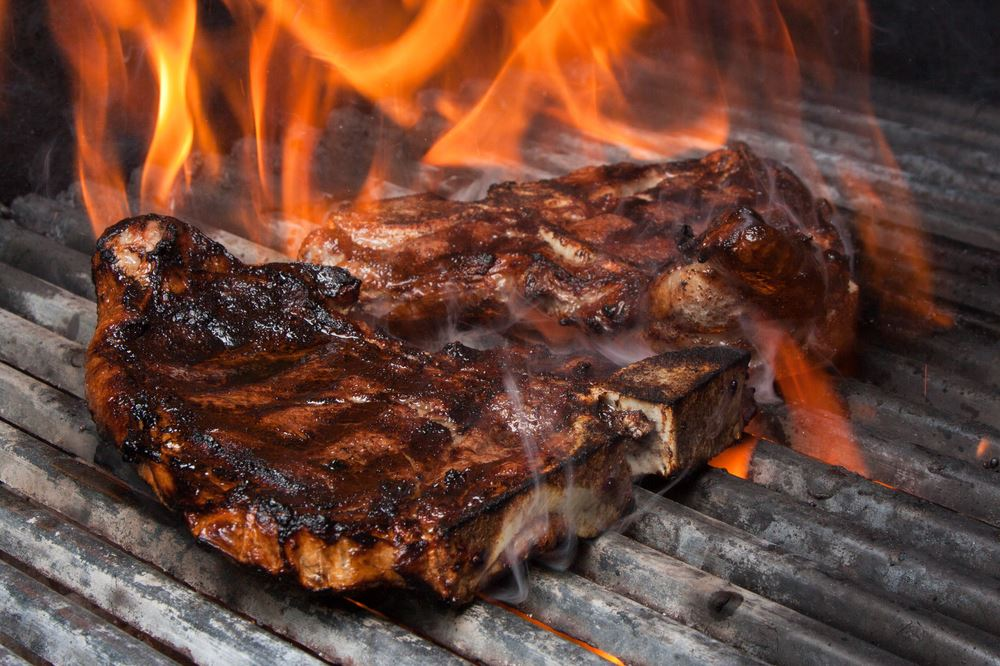 Steak cooking on gas grill